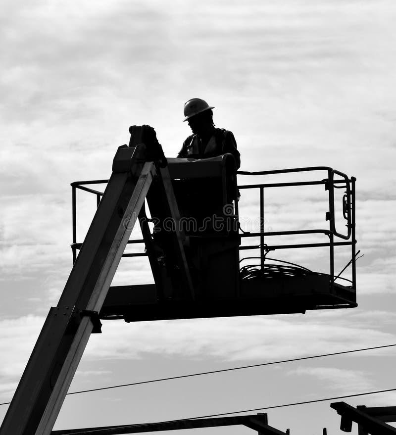 桥梁建筑工作者操作平台推力 免版税库存照片