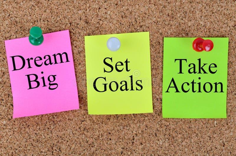 梦想大集合目标采取在笔记写的行动 免版税库存照片