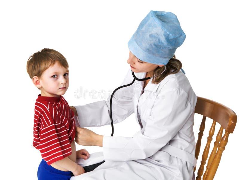 检查女性病残的男孩医生 免版税库存照片