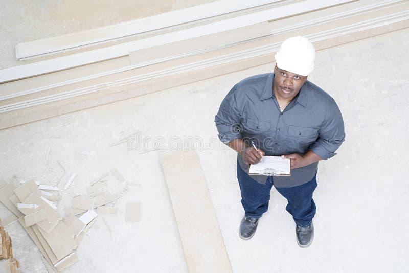 检查房子的建造者 免版税库存图片