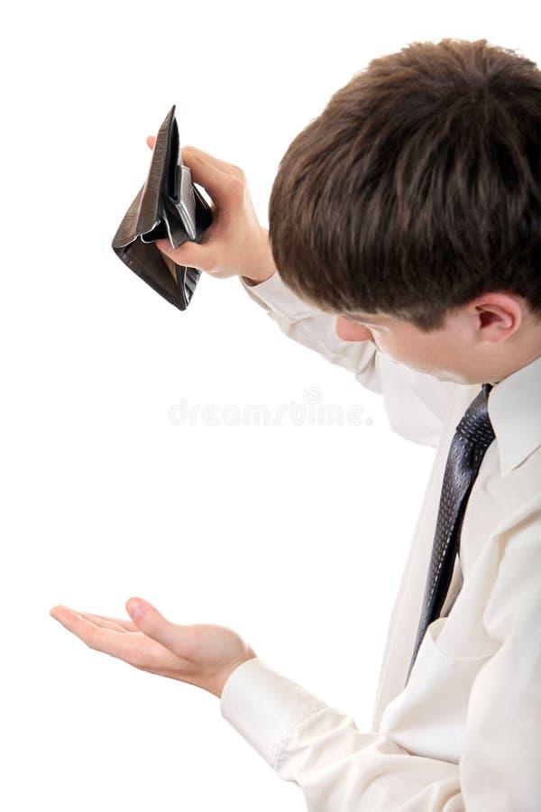 检查空的钱包的年轻人 免版税库存图片