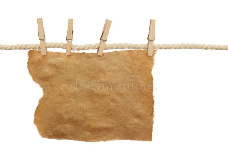 棉花绳索和四个别针有工艺纸张的  免版税库存照片