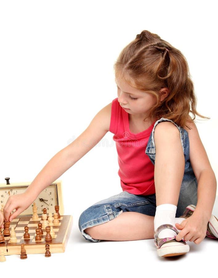 棋女孩使用的一点 图库摄影
