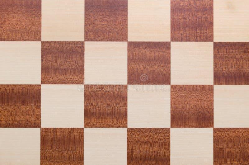 棋枰纹理顶视图 方格的木背景 库存图片
