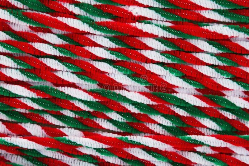 棒棒糖用管道输送圣诞节背景 免版税图库摄影