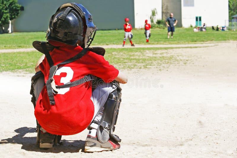 年轻棒球捕手 库存照片