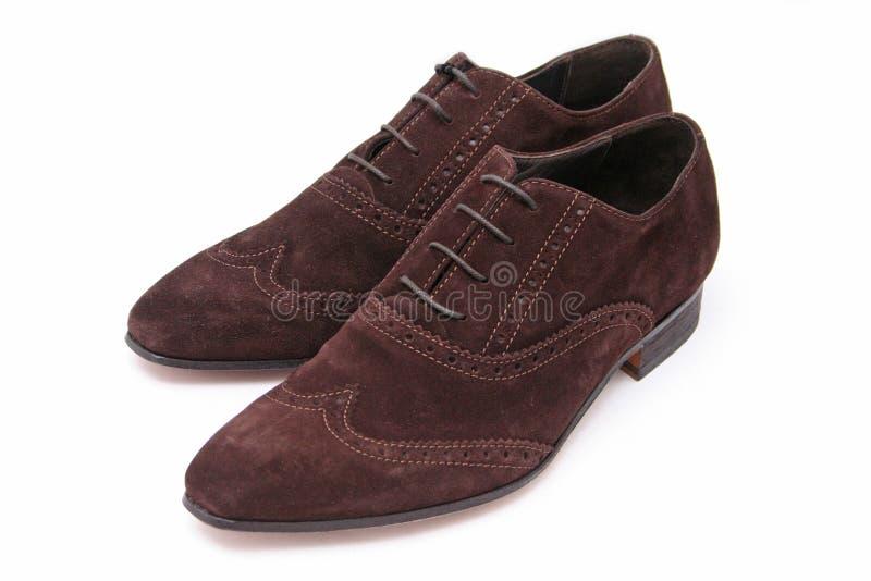 棕色人鞋子绒面革 免版税库存照片