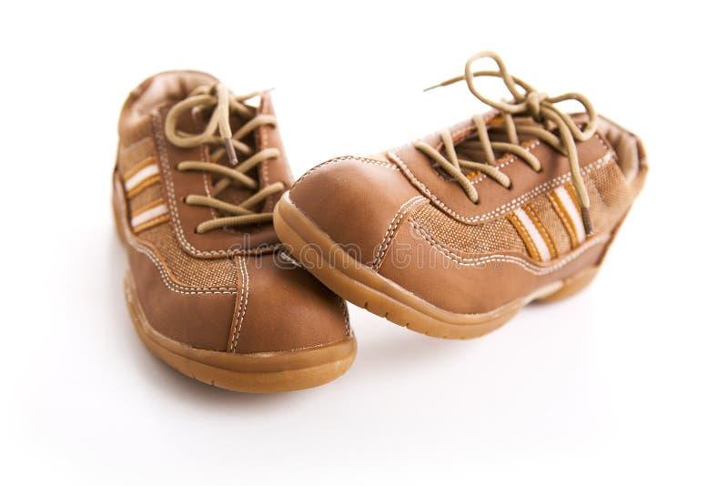 棕色儿童s鞋子 图库摄影