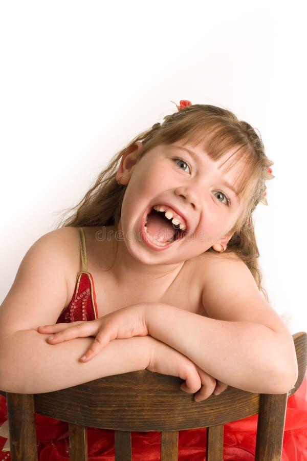 棕色椅子女孩 免版税库存图片