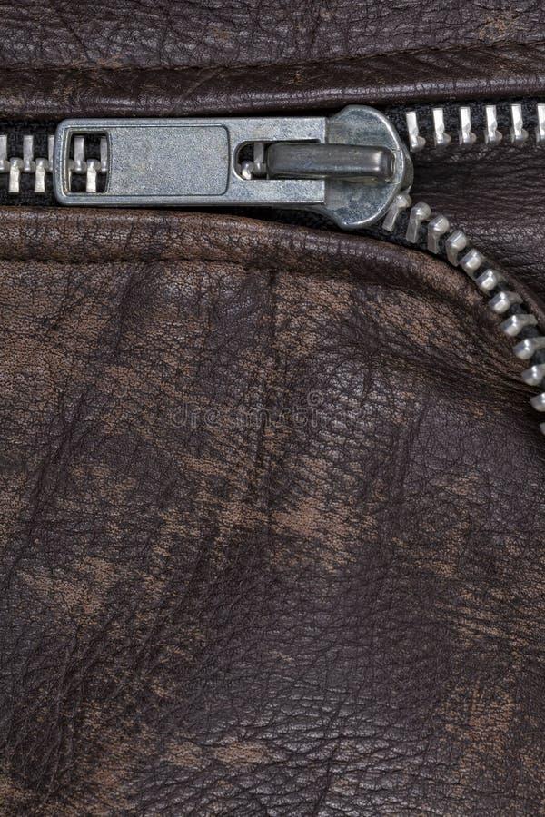 棕色皮夹克的拉链 库存图片