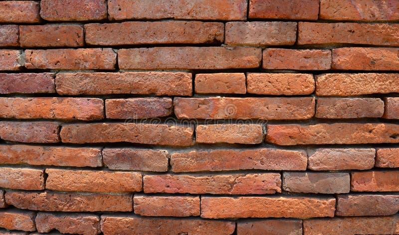 棕色石头-铺片段的石砖地无缝的纹理-老岩石纹理  免版税库存照片