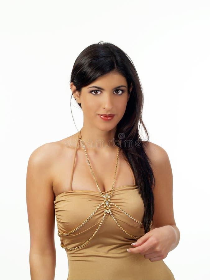 棕色礼服东部典雅的中间妇女 免版税库存照片