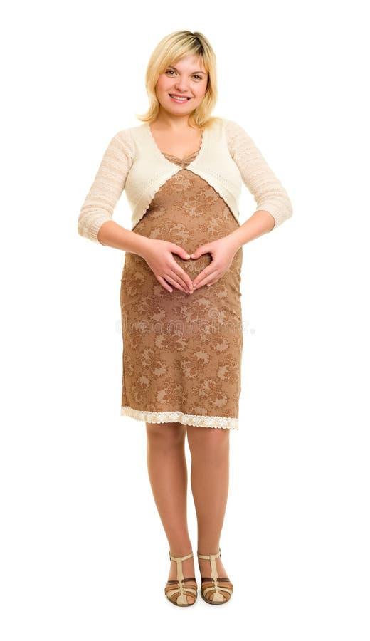 棕色礼服的孕妇 免版税图库摄影