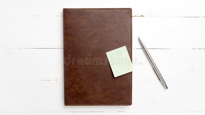 棕色笔记本笔 免版税库存照片