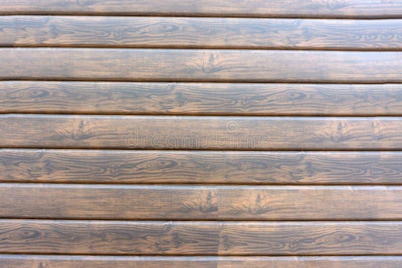 棕色老自然木有树地板样式纹理特写镜头金子视图表面的板条黑暗的年迈的空的农村室背景  库存图片