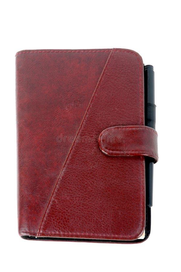 棕色闭合的皮革笔记本 库存图片