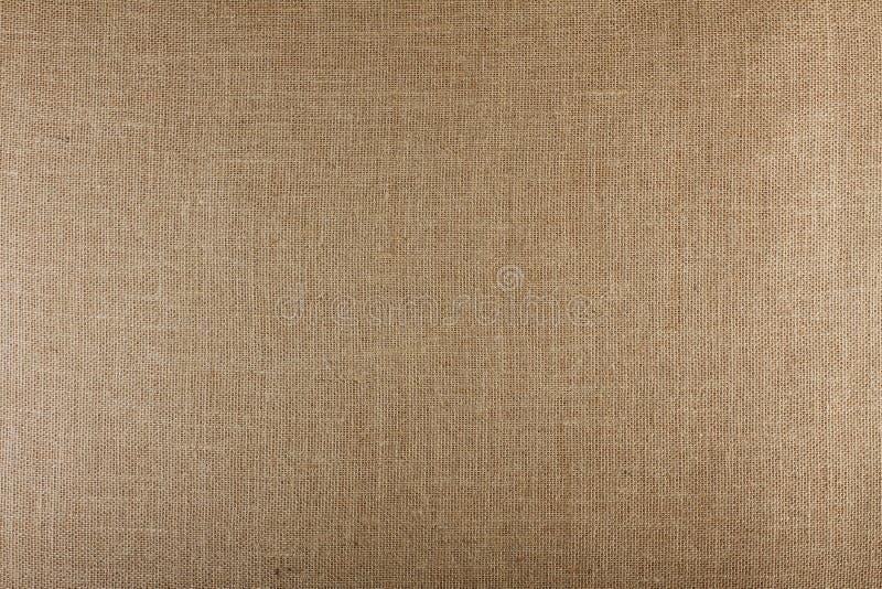 棕色织地不很细表面,粗麻布纹理背景特写镜头  免版税库存照片