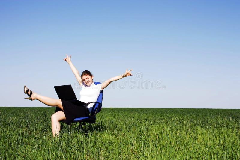 椅子域绿色妇女 库存图片
