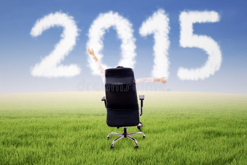椅子的妇女与第2015年 免版税库存照片