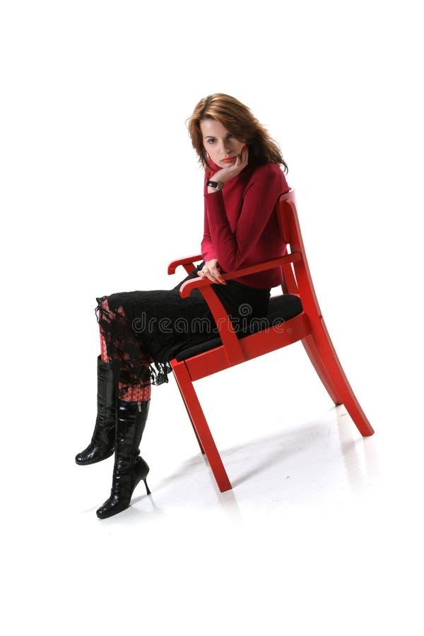 椅子的时髦的女人 库存照片