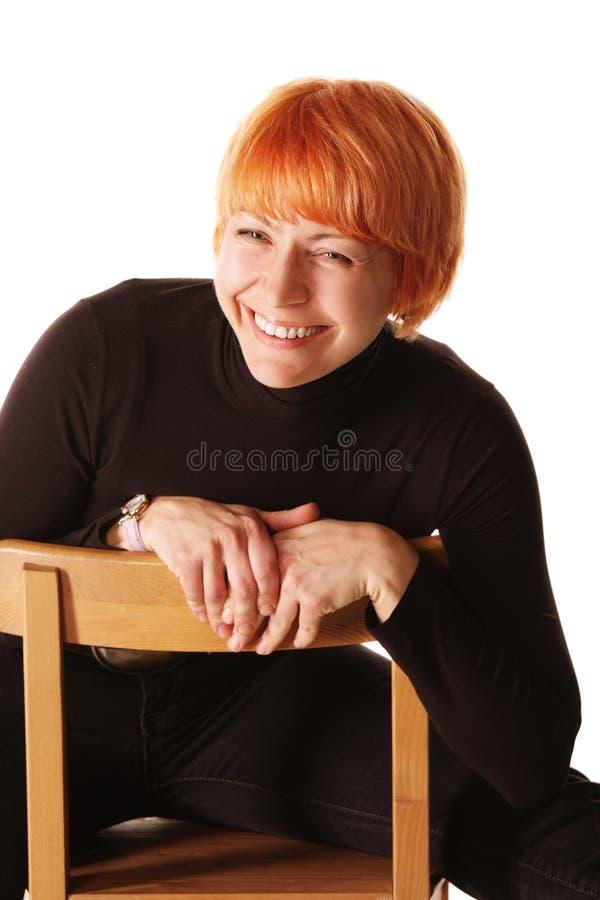椅子笑的妇女 库存照片