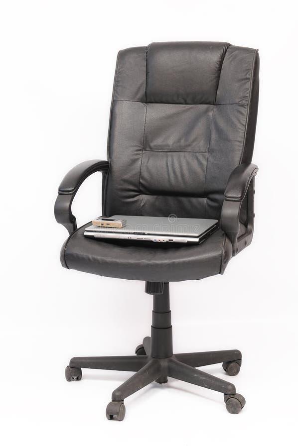 椅子膝上型计算机 免版税图库摄影