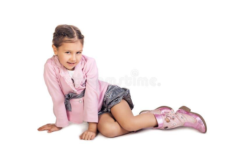 楼层女孩坐的一点 免版税库存图片
