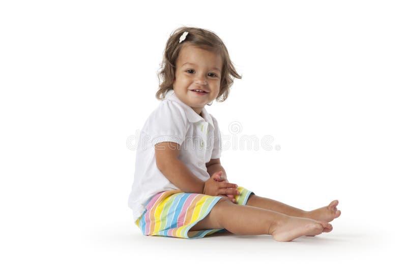 楼层女孩愉快的坐的小孩 库存图片