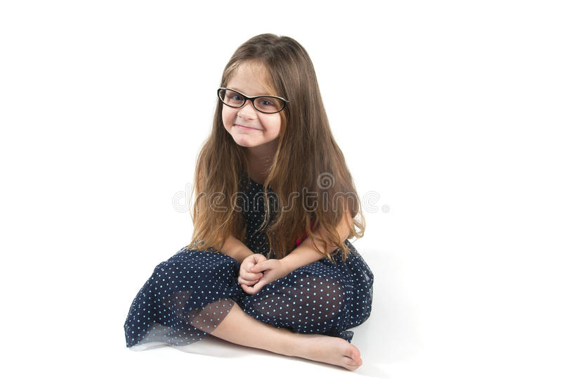 楼层滑稽的女孩坐的一点 库存图片