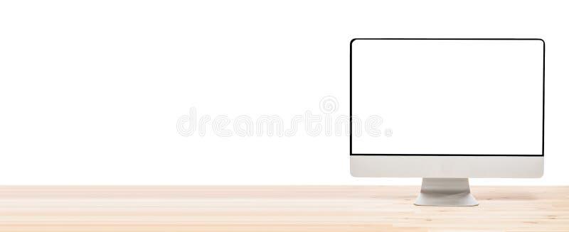 概念性工作区或企业概念 与空白的白色屏幕的大计算机显示器显示在轻的木桌上 查出 库存图片