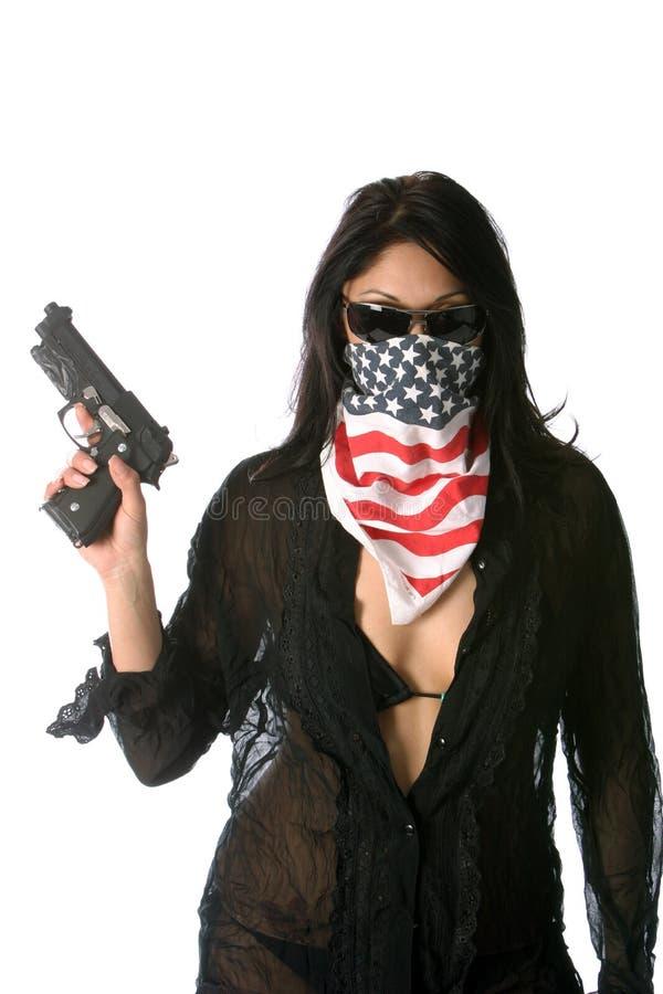 概念热女孩的枪 图库摄影