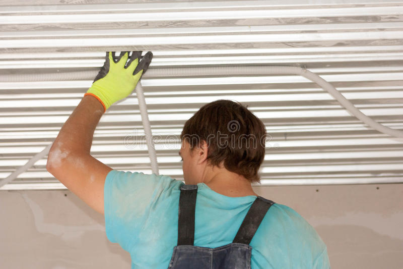 概念建筑手指金子安置关键字 工作者劳动过程 库存照片