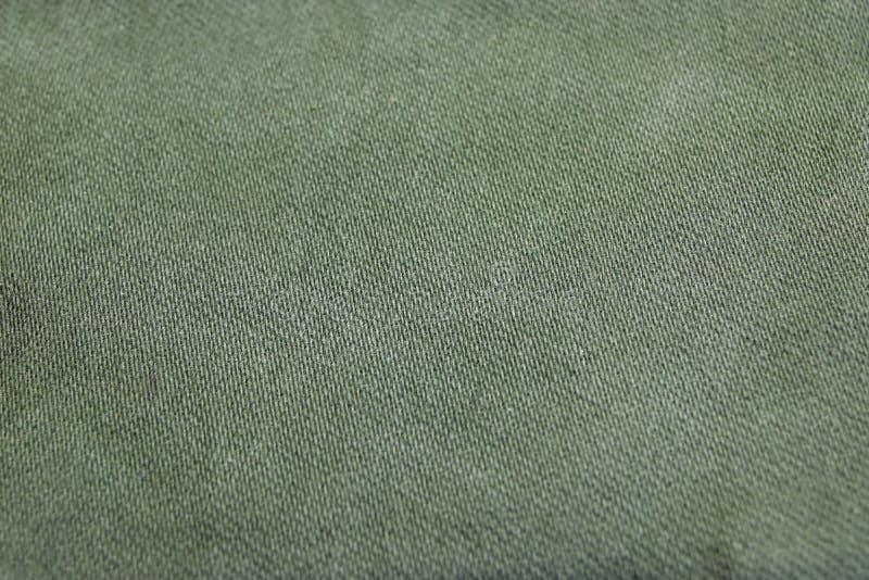 概略的卡其色的军事纺织品或样式背景 库存照片