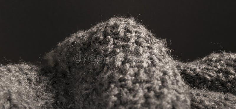 概略的被编织的灰色羊毛织品背景 库存图片