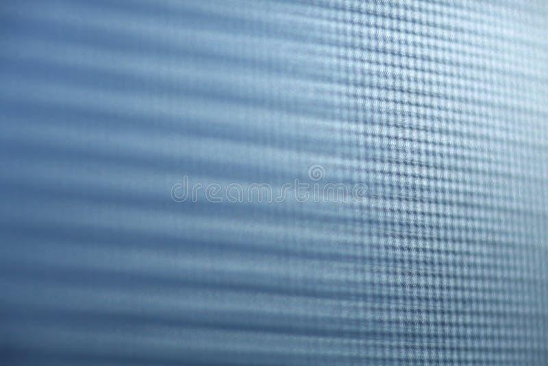 模糊的右边被聚焦的蓝色纹理 库存照片