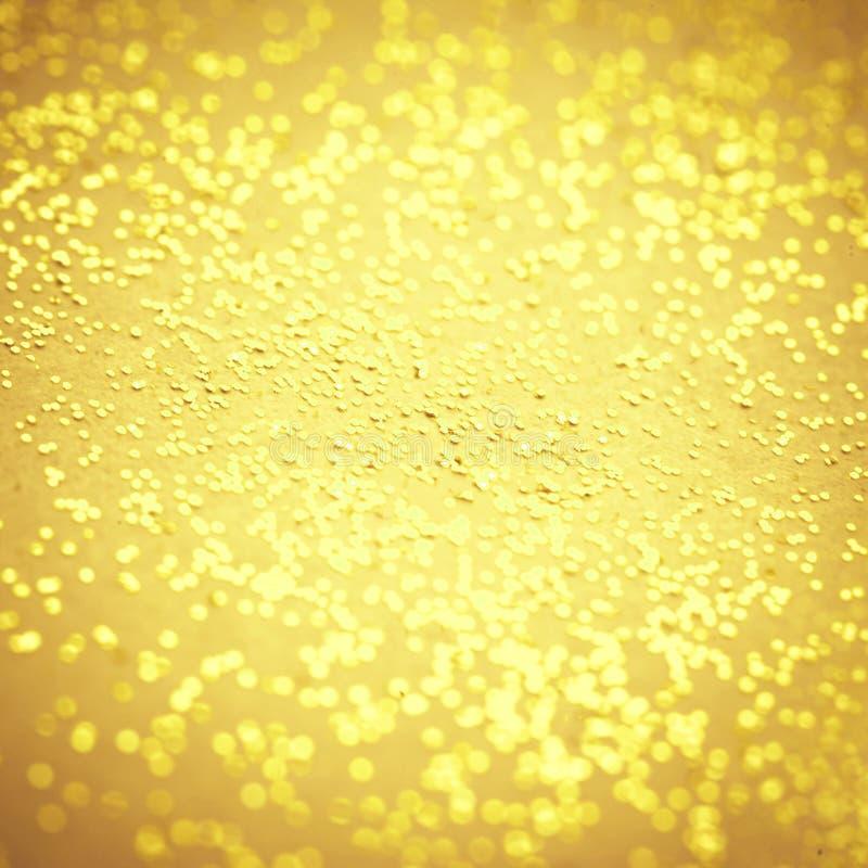 模糊的金闪闪发光纹理 抽象Bokeh金黄闪烁backg 库存图片
