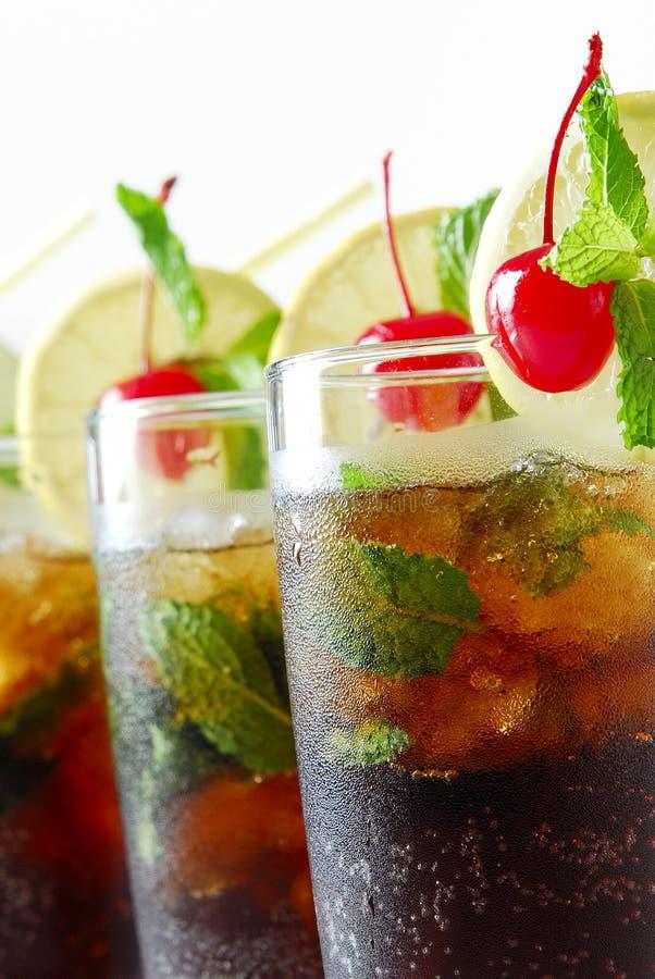 樱桃可乐玻璃 免版税图库摄影