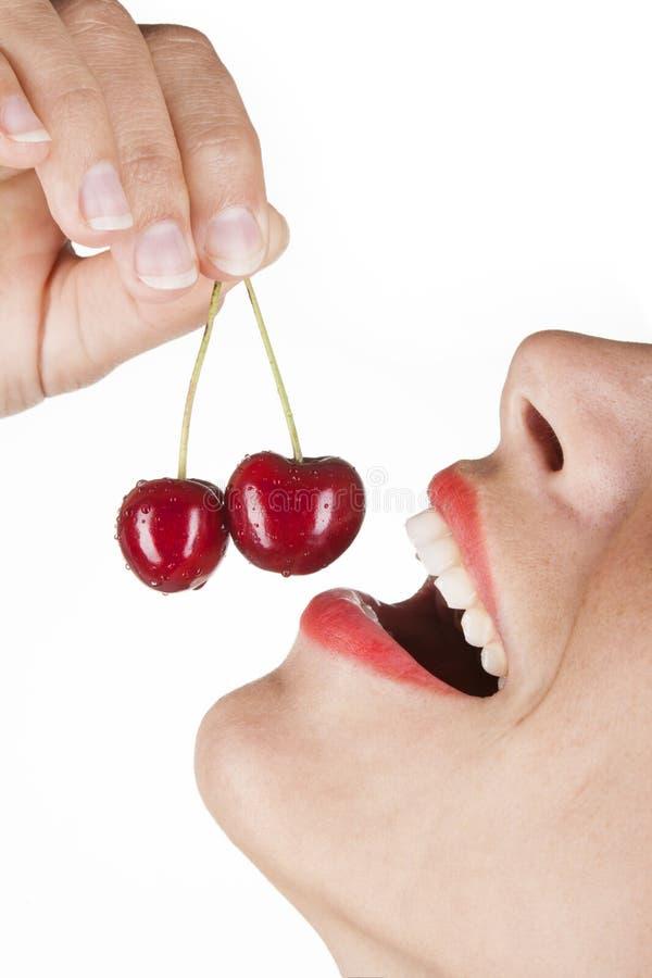 樱桃吃红色 库存图片