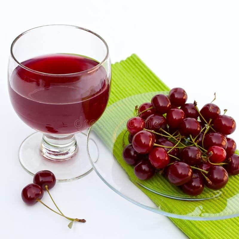 樱桃新鲜的汁 免版税库存照片