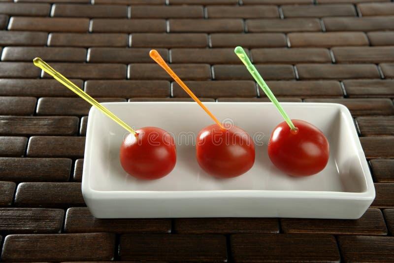 樱桃颜色停留三个蕃茄 免版税库存图片