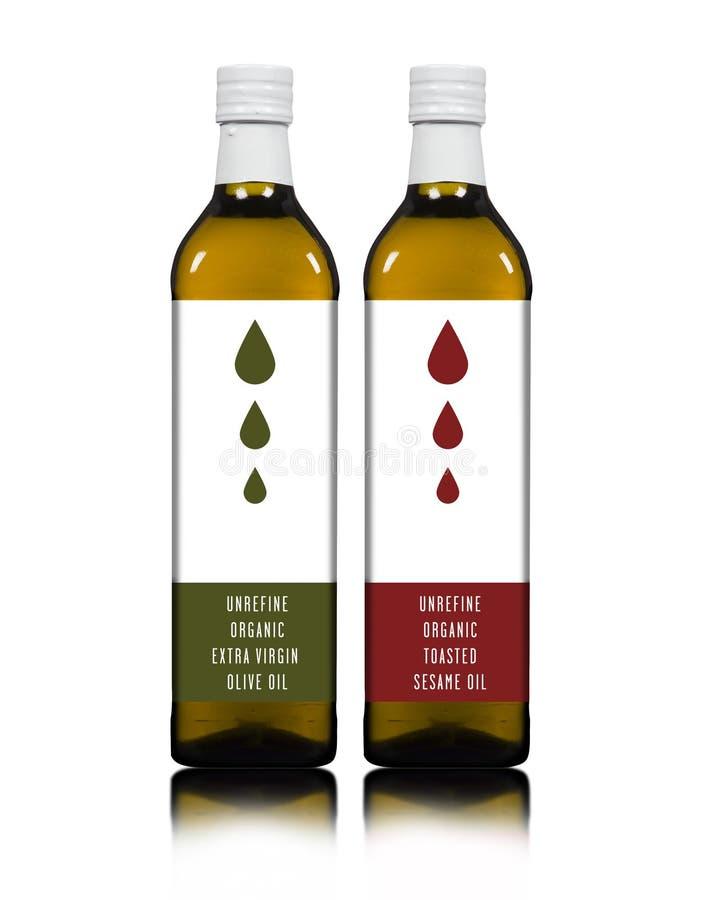 橄榄和香油瓶 免版税库存照片