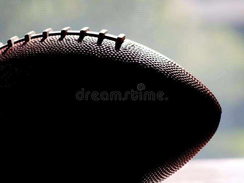 橄榄球剪影视窗 免版税库存图片