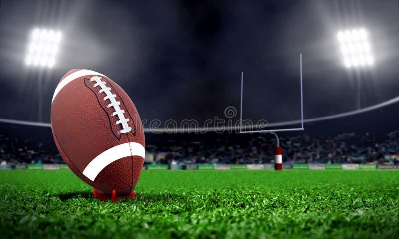橄榄球在体育场内在晚上 免版税库存照片