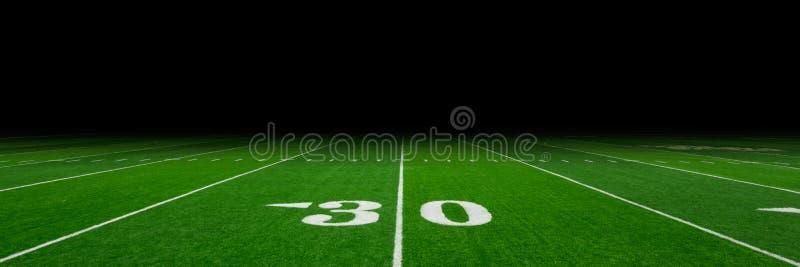 橄榄球场背景 免版税库存图片