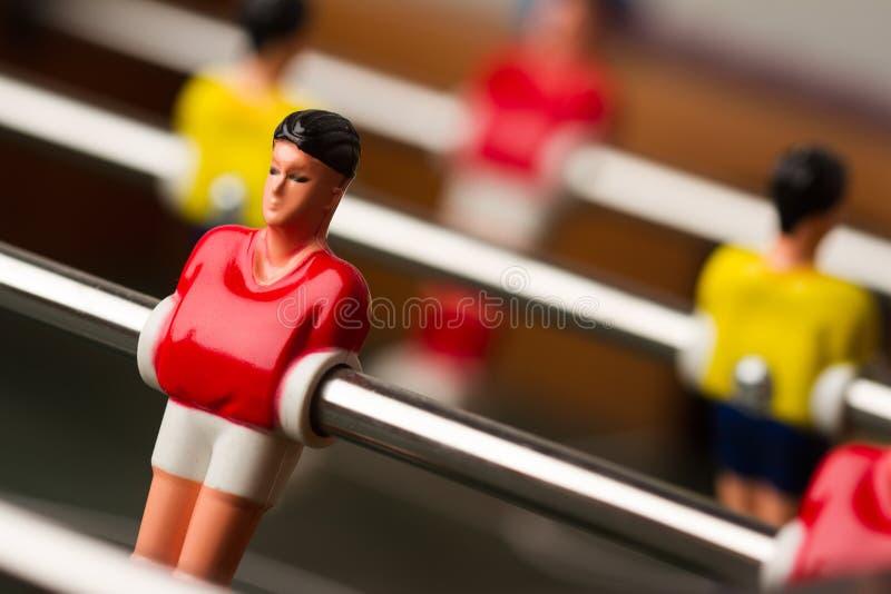 橄榄球小雕象特写镜头在foosball桌足球赛的 免版税库存照片