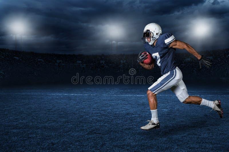 橄榄球比赛行动照片 库存照片