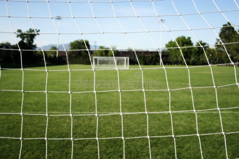 橄榄球网足球 免版税库存照片