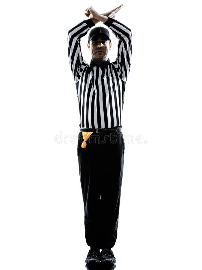 橄榄球裁判员打手势个人犯规剪影 免版税库存照片