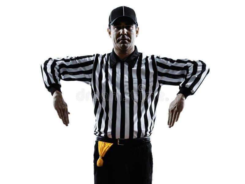 橄榄球裁判员打手势剪影 库存图片