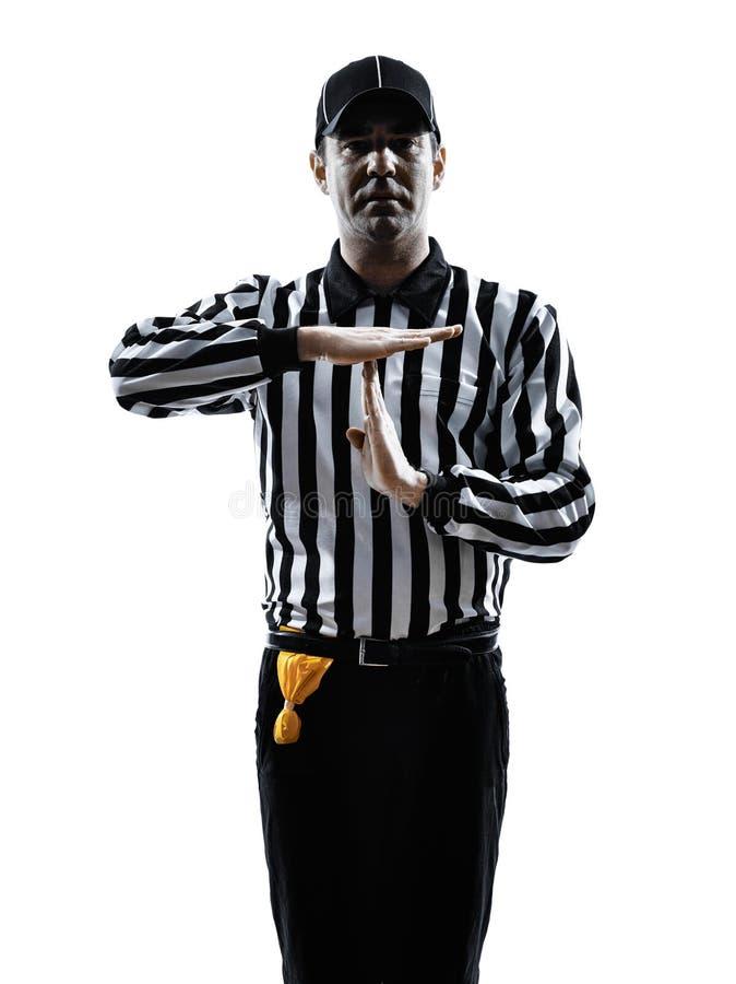 橄榄球裁判员打手势时间现出轮廓 免版税库存图片